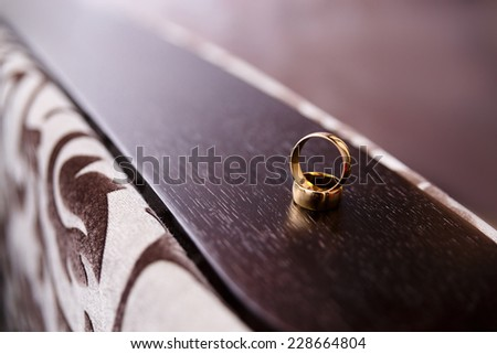 two wedding rings on wooden furniture parts - stock photo
