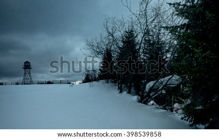 Two well-camouflaged soldiers. Surveillance of the object. Two military men hiding in a winter landscape. - stock photo