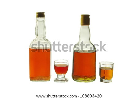 Two whiskey bottle and two glasses. Isolated on white background