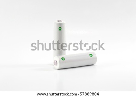 two white aa batteries isolated on white - stock photo