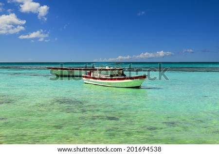 Two white and red boats on azur exotic Caribbean Sea - stock photo