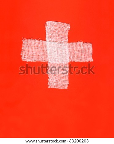 Two white bandages forming a cross on red background