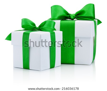Two White boxs tied green ribbon bow Isolated on white background - stock photo