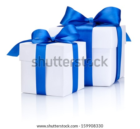 Two White boxs tied with a blue satin ribbon bow Isolated on white background - stock photo