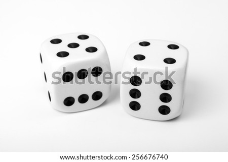 Two white dice isolated on white