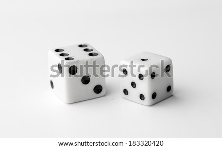 Two white dice thrown to reveal the values six and one - stock photo