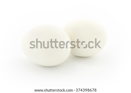 Two white eggs, isolated on white background