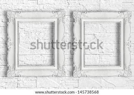 Two white frame on brick wall - stock photo