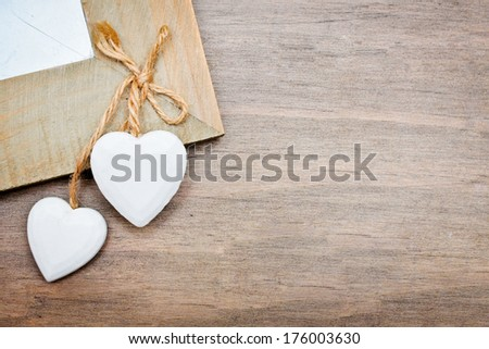 Two white hearts on a wooden surface - stock photo