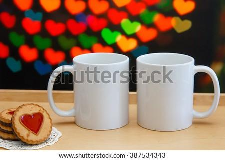 two white mugs cookies near them stock photo 387534343 shutterstock