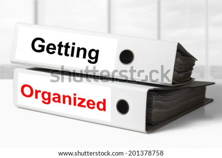 two white office binders getting organized