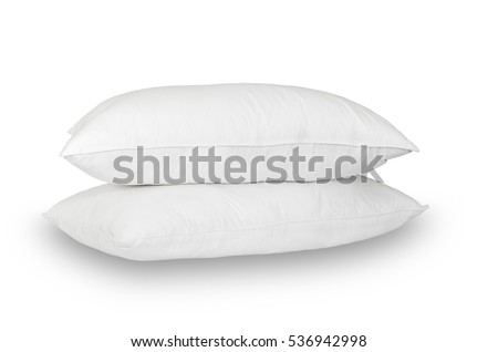 Two white pillows are stacked on a white background