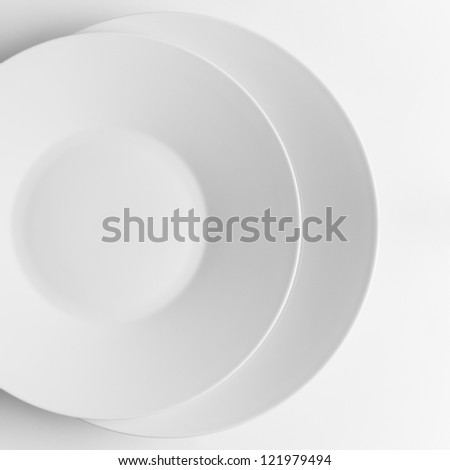 two white plates superimposed on a white background