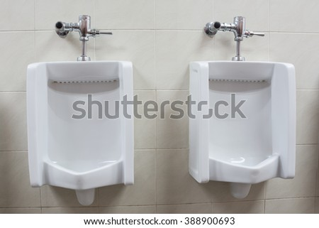 Two White Urinals In Menu0027s Bathroom