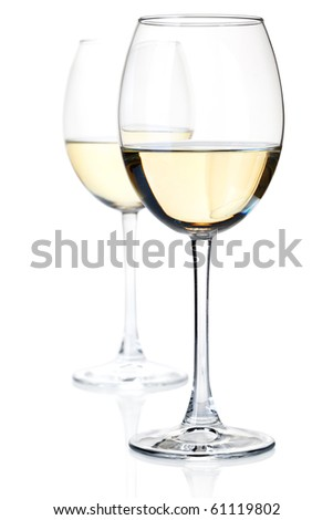 Two white wine glasses. Isolated on white, small DOF - stock photo