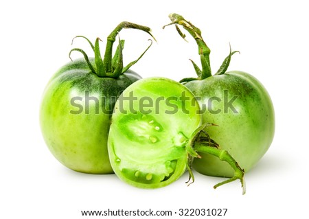 Two whole and half green tomatoes isolated on white background