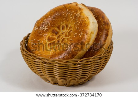 Two whole buns with sesame seeds - stock photo
