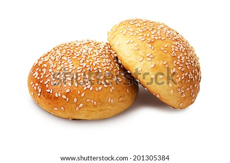 Two whole buns with sesame seeds isolated on white - stock photo