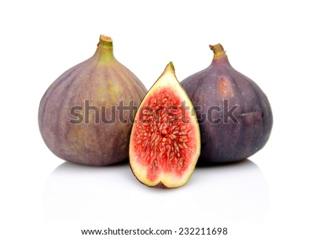 Two whole figs with quarter isolated on white background - stock photo