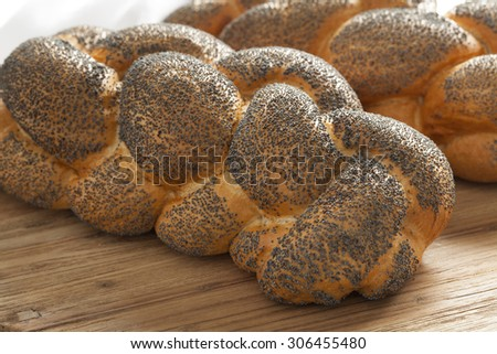 Two whole fresh Challah breads with poppy seeds   - stock photo