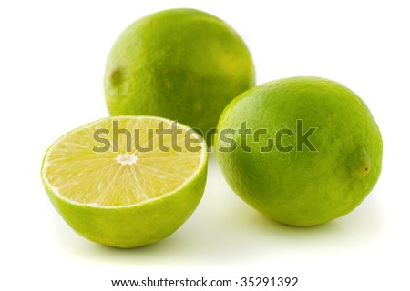 Two whole limes and a half lime isolated on white background - stock photo