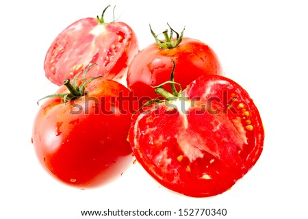 Two whole red tomatoes and two half Isolated on white background - stock photo