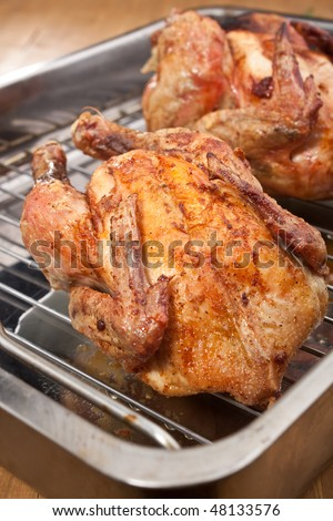 two whole roasted chickens - stock photo