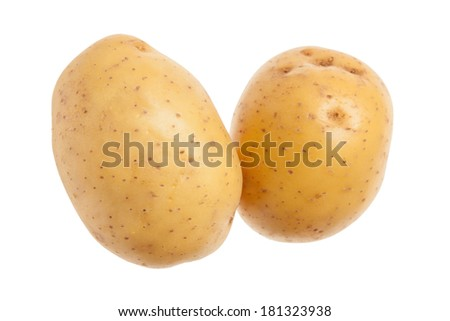 Two whole yellow potatoes. Isolated on white background. Close-up studio photography. - stock photo