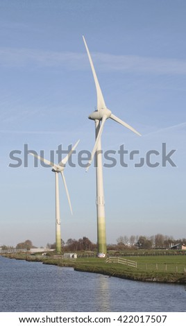Two wind mills in a dutch landscape