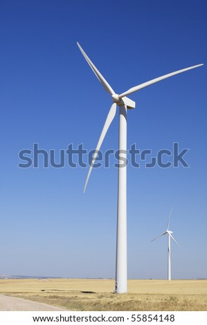 two windmills with a clear blue sky