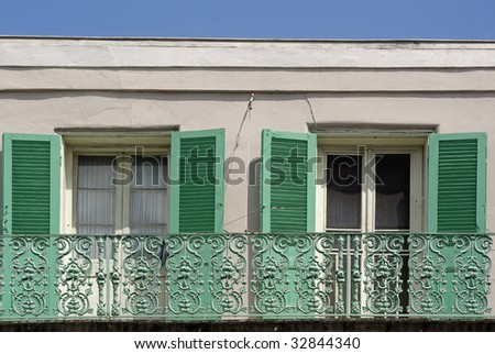 windows new orleans balcony two windows and balcony in new orleans windows balcony stock photo royalty free 32844340