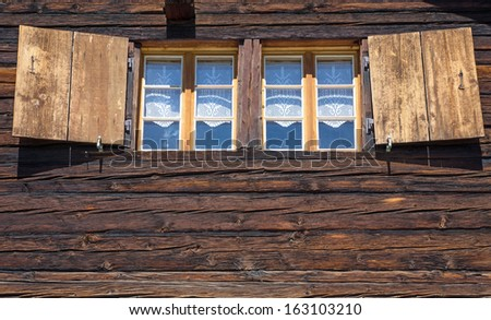 Two windows of a wooden hut - stock photo