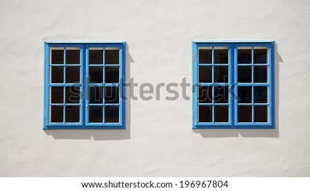 two windows on the wall - stock photo