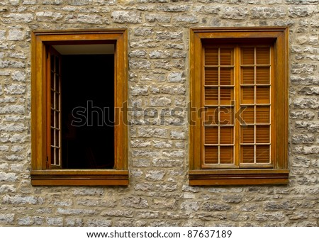 Two Windows, one open, set in old stone wall in Old Quebec City, Quebec, Canada - stock photo