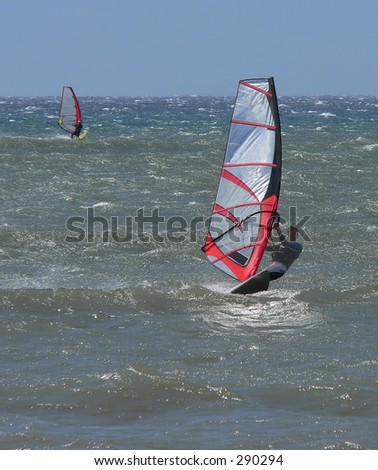 Two windsurfers enjoy the day in Maui, Hawaii
