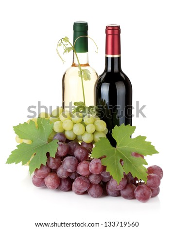 Two wine bottles and grapes. Isolated on white background - stock photo