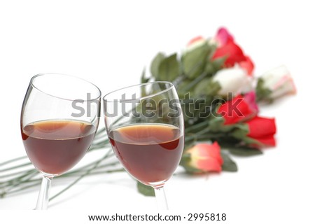 Two wine glasses  and roses at the background - stock photo