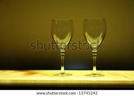 Two Wine Glasses on a Counter - stock photo