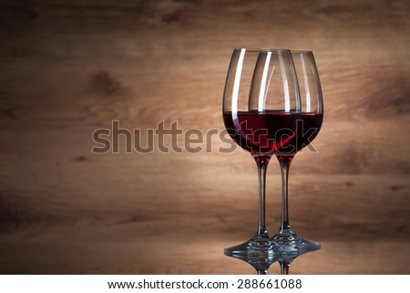 Two wine glasses on a wooden background