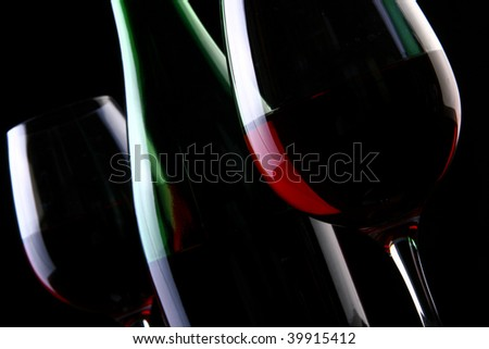 two wine glasses on black - stock photo