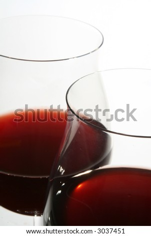 Two wine glasses with red wine close up on  grey background