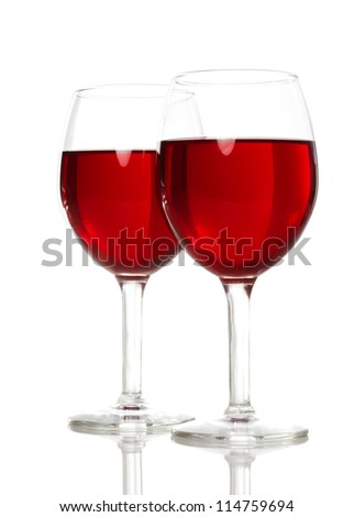 Two Wine Glasses with Red Wine on White Background - stock photo