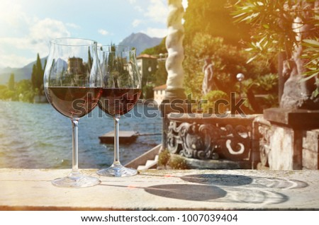 Two wineglasses. Varenna town at the lake Como, Italy