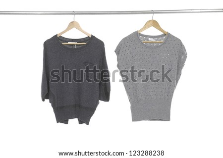 Two woman clothes on a hanger studio isolated - stock photo
