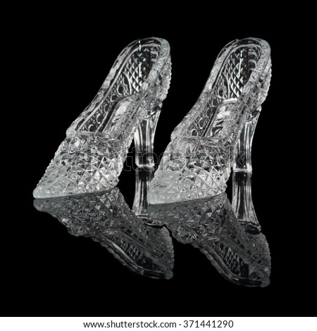 Two woman crystal shoes on the black background - stock photo
