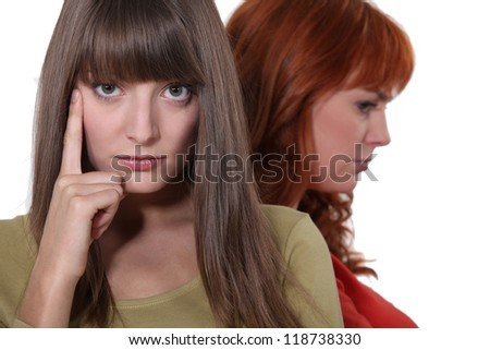 Two woman post argument - stock photo