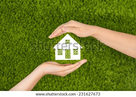 Two Woman's open hands making a protection gesture  isolated on green background.Property insurance and security concept .