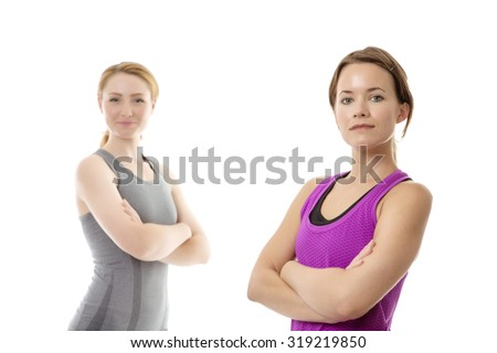 two woman standing one in front of the other ready for a work out