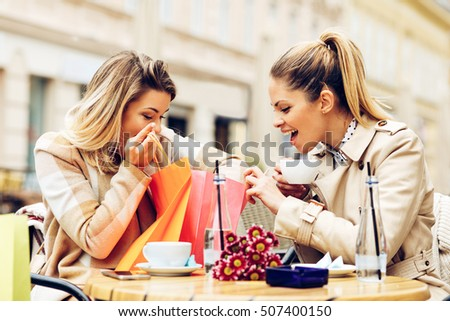Two women after shopping in cafe