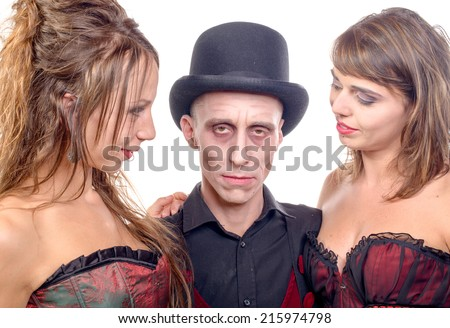 two women and a man in disguise in vampire for halloween - stock photo